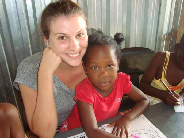 Volunteer with school children in South Africa