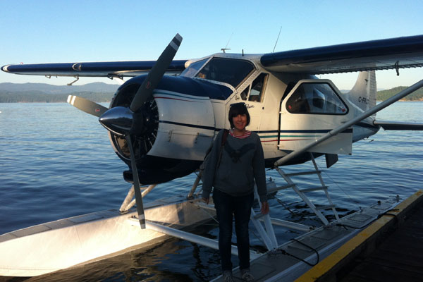 Catherine next to a float plane on Pender Island