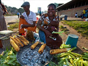 Lady cooking corn, KwaZulu-Natal. Photo By Durban Tourism