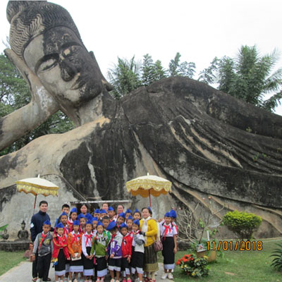 Group by a huge stone buddha