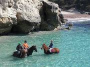 Horse riding in the sea in Menorca. Photo from Audax Hotels
