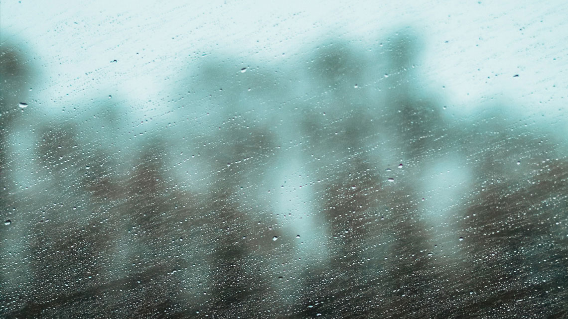 View through a rain-splattered window