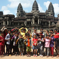 Happy children in front of temple complex