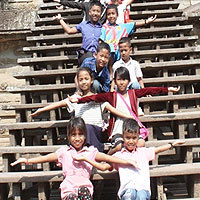 Children posing on a staircase