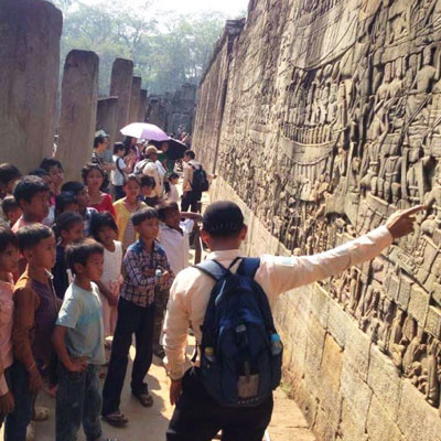 Guide explaining the wall carvings