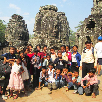 Group in front of stone ruins