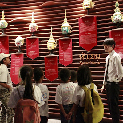 Children looking at masks