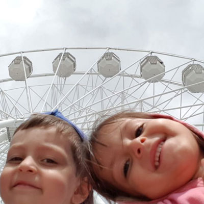 Children and big wheel