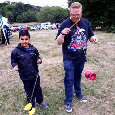 Child and adult playing with diabolo toy