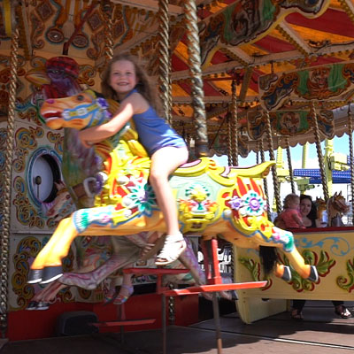 Little girl on carousel horse