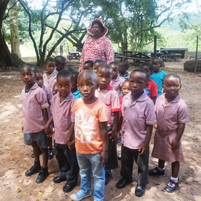 The group of children with one of their teachers