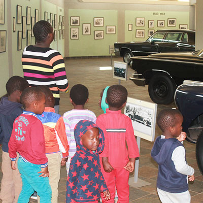Children looking at the cars