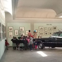 children looking at the old cars