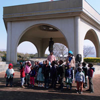 Children standing in front of a monument