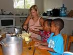 Volunteer with children in Belize