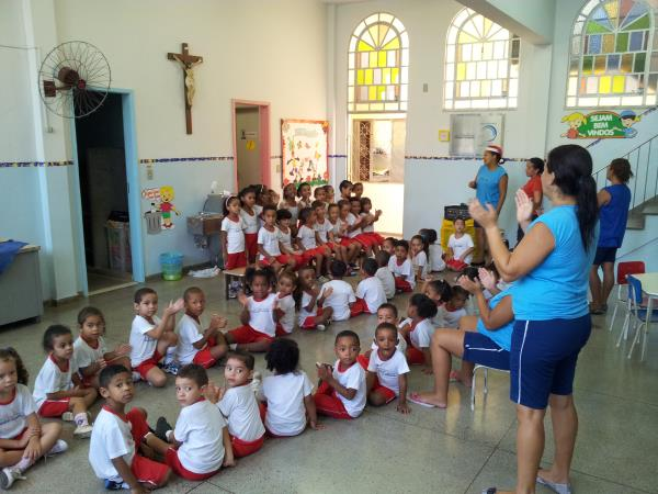 Volunteer with children at a creche in Brazil