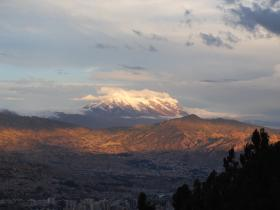 Mt Illimani hovers over the ciy of La Paz