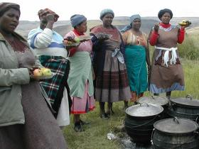 Women from the community preparing dinner