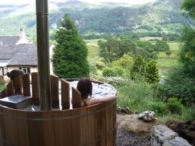 Relax in the log-fired hot tub in the wood - available for exclusive use