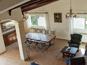 Upper dining room, containing a large wrought iron custom made dining table with its mosaics top