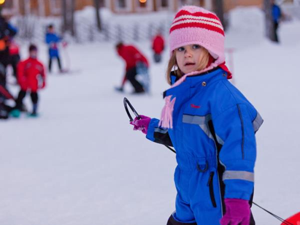 Family winter activity holiday in Finland