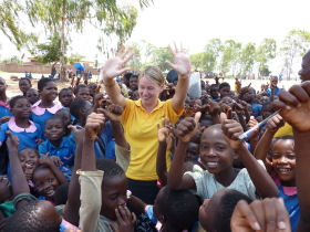 Volunteer with children in Zambia