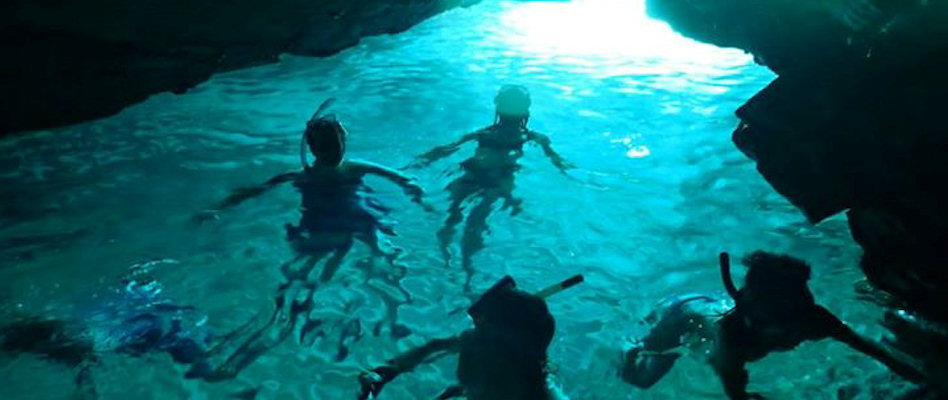 Kids swimming in a cave