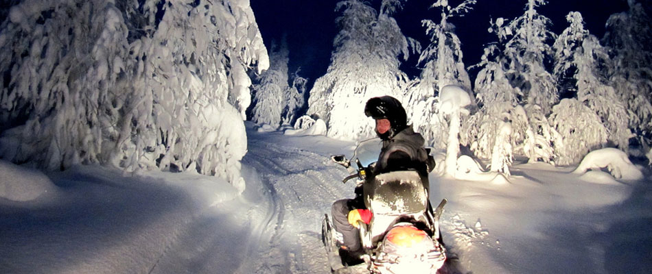 Snowmobile at night, Lapland. Photo by Heather Sunderland
