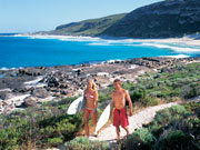 Surfers at Conto Springs Beach in Western Australia. Photo by Tourism Western Australia