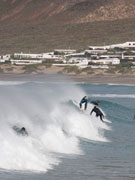 Surfers in Famara, Lanzarote. Photo by Nick Haslam