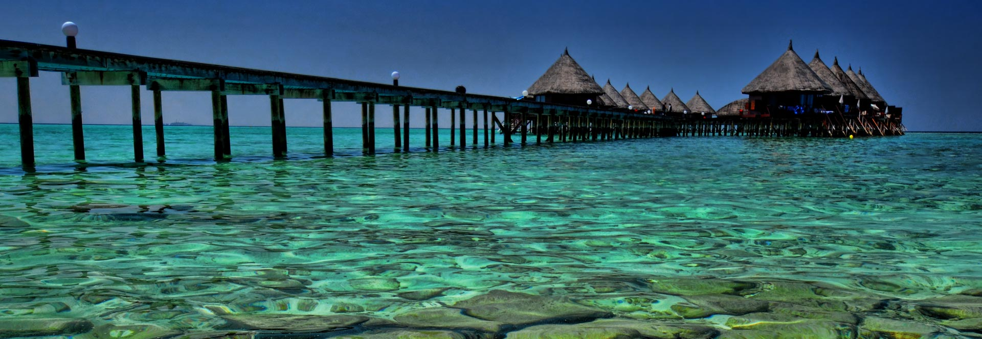 Luxury beach resorts holidays world 39 s best responsible for Luxury holidays worldwide